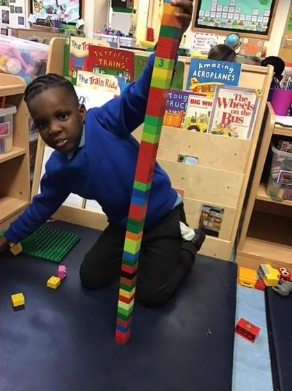 Joshua used some super size words when making his tower.