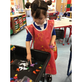 Aliah experiments which sorting toys sink or float.