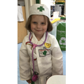 Isla Rose dressed up as a doctor in the toy hospital