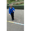 Measuring how far cars have gone after the ramp.