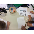 Non fiction writing - children wrote about what they would take with them on a journey.