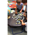 Working together to complete a world map puzzle.
