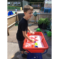 Alfie enjoying water play