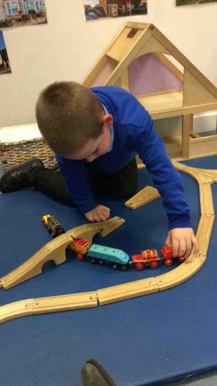 Kenzie   was fully focused as he constructed a bridge and  drove the train under.