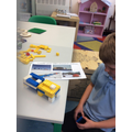 Isaac building a research station.