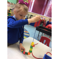 Milana was threading and began counting the beads.