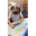 We use Numicons to create some subtraction number sentences.