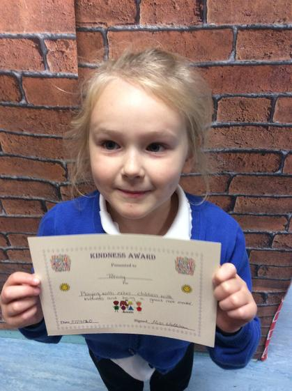 Week 3 - Tiffany for being kind to the other children and being a good role model.