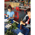 Evie and Alfie making trees for their creatures habitat