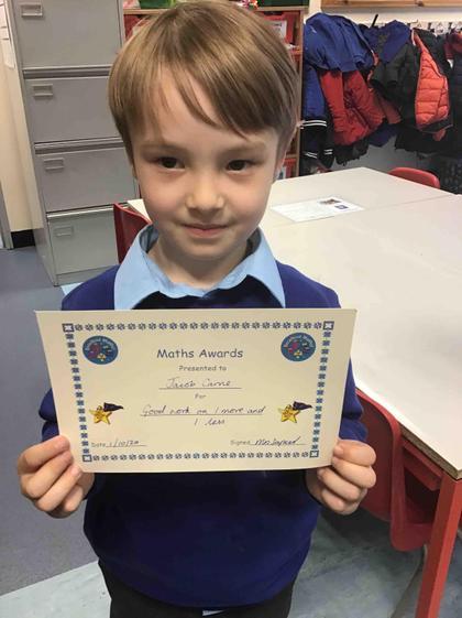 Week 4- 1.10,20 Jacob earned an award for great maths work.