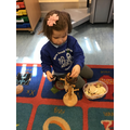 Isla-Rose explored the loose parts.
