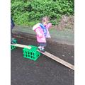 Ava shows good balancing skills as she walks down the plank