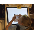 Jessica practising her drawing skills using the light box.