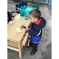 Victor was learning to use the hammer and nails