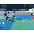 Practising tennis skills in our Greenacre session