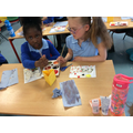 Painting our designs.