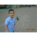 Harvey set up hopscotch and enjoyed playing