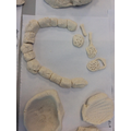 Making pots and jewellery inspired by Stone Age artefacts.
