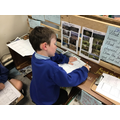 Frankie working on his Geography learning challenge to compare 2 countries.