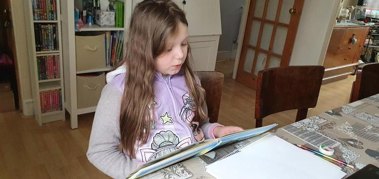 Sofia reading her book