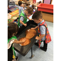 The children enjoy using their hands to explore the feel of baked beans