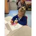 Marcella uses good pencil control to trace over the patterns.