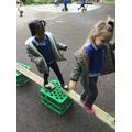 Hafsa and Kara show good balancing skills as they walk across the planks