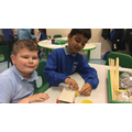 We started building our cars by making chassis with axles and wheels.