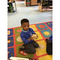 Rayyan made a burger using the loose parts