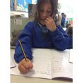 Maria focusing on her handwriting.