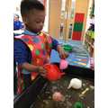 Rayyan explored filling and pouring with water