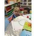 Scarlett and Nia perform a puppet show of Goldilocks and the Three bears