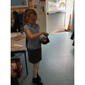 Using the singing bowl for making soothing sounds.
