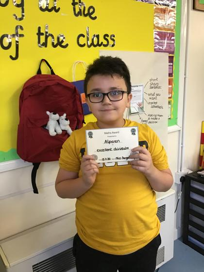 Alperen worked hard on his division this week, writing remainders as decimals.