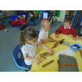 Rolling and cutting the gingerbread people