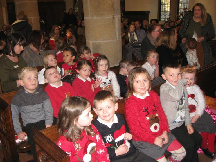 Singing carols in our Christmas jumpers