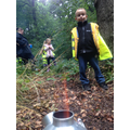 Charlie helped boil water for a wild berry drink.