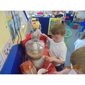 Pressing the button to make the dough