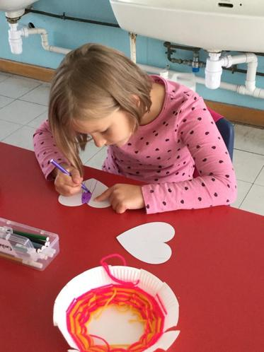 Lena making colourful 3D hanging hearts!