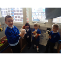 Re-telling the story using the animal puppets