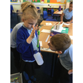 Testing the gravitational pull of a bottle.