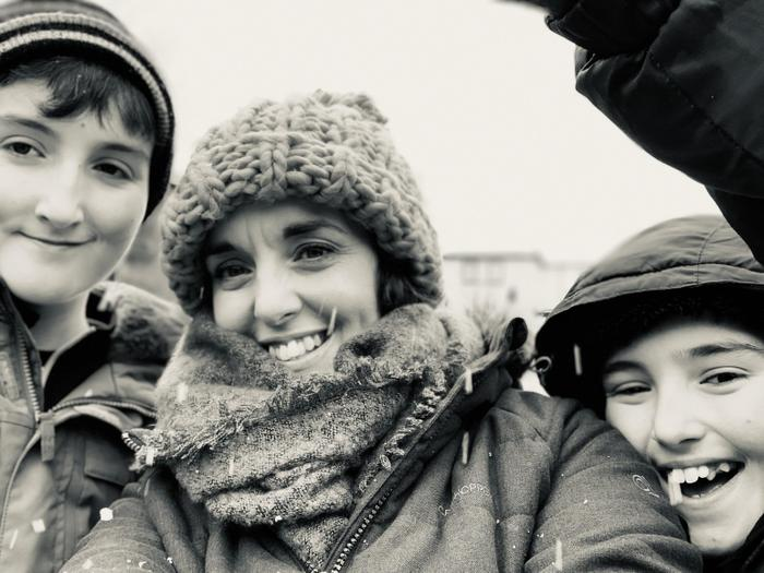 Mrs Johnson, having fun in the snow with her boys.