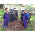 We raked leaves into the compost bin.