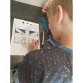 Charlie working on a flag for VE Day!