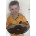 Samuel enjoyed baking some chocolate chip cookies!