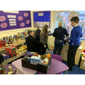 Pupils  keen to help sort the food into hampers.