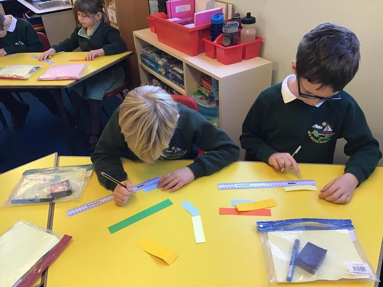 Using a ruler to measure strips of paper