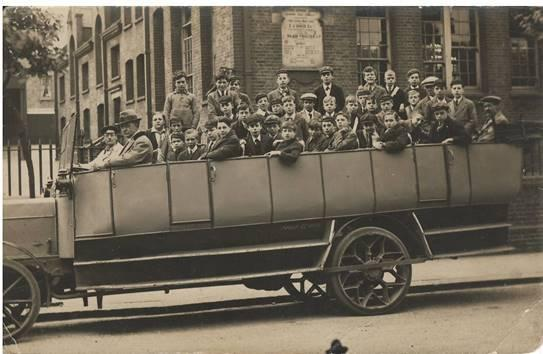 Pupils in a charabanc, ready to go on a school trip