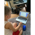Bogdan busy on his laptop.