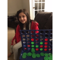 Sophia has been learning how to play Connect 4.